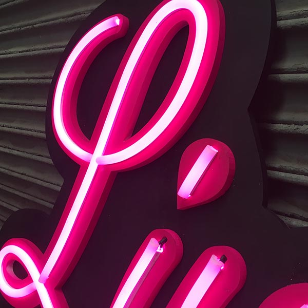 Closeup of Live Ink pink LED neon sign